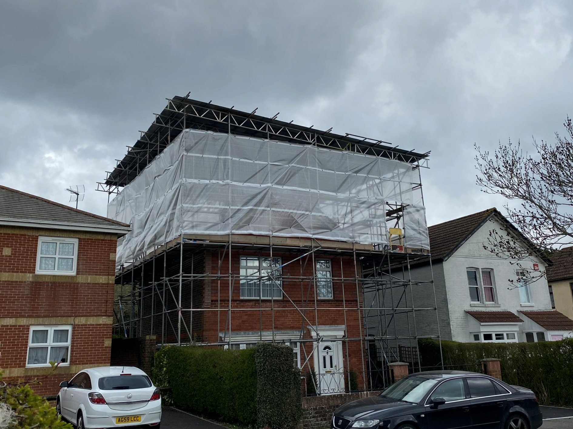 Scaffolding work Temporary roof scaffolding over a residential house
